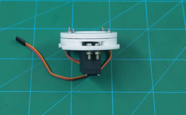 attach base servo motor plate to thetop outer bearing disc1