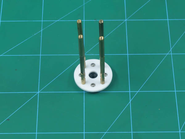 attach standoffs to the inner bearing disc