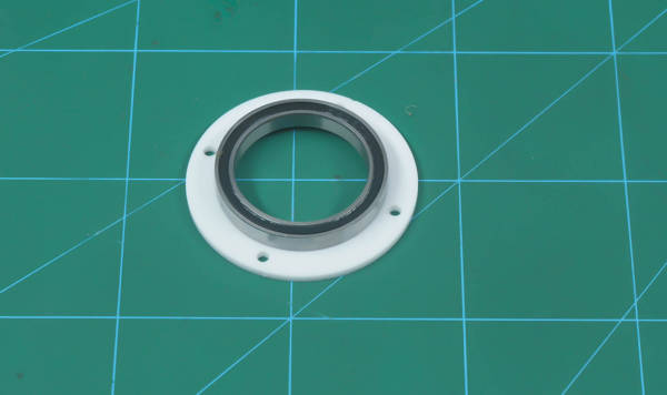 place bearing in the bottom outer bearing disc