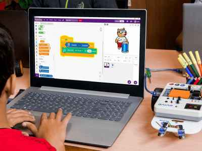 Child programming on Pictoblox
